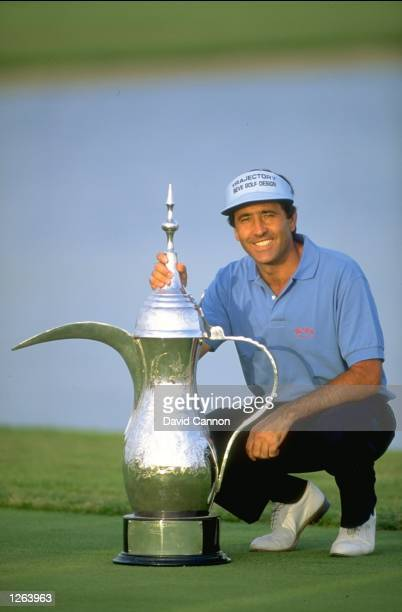 Seve Ballesteros of Spain poses with the trophy after winning the Dubai Classic at the Emirates Golf Club in Dubai United Arab Emirates Mandatory...
