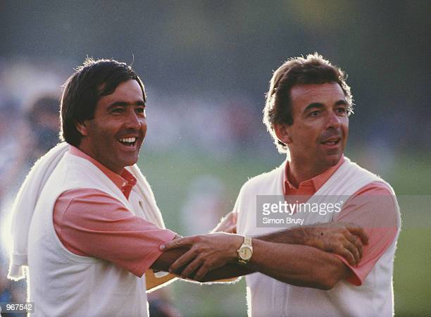 Seve Ballesteros of the European team celebrates with captain Tony Jacklin during the 27th Ryder Cup Matches on 26th September 1987 at the Muirfield...
