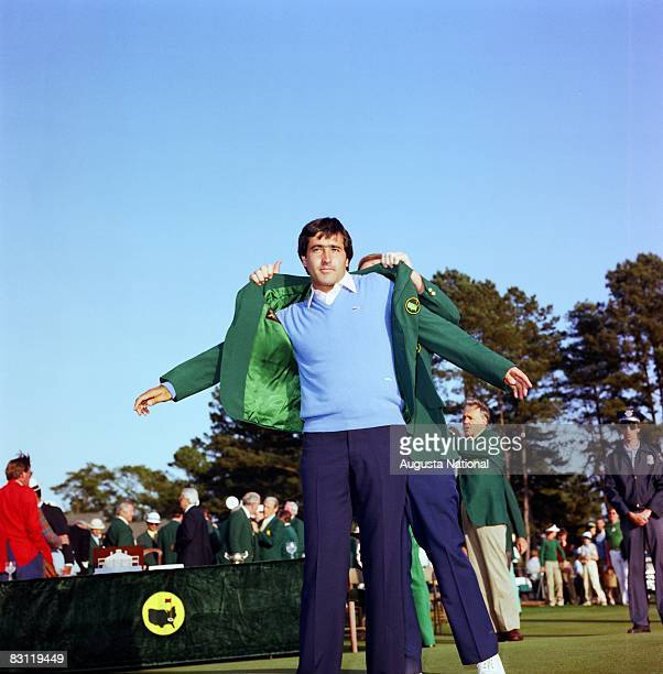 Seve Ballesteros puts on the Green Jacket during the 1983 Masters Tournament at Augusta National Golf Club on APRIL 11th 1983 in Augusta Georgia