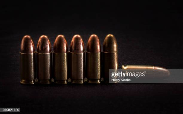 seven 9mm bullets in a row - fallen soldier stock pictures, royalty-free photos & images