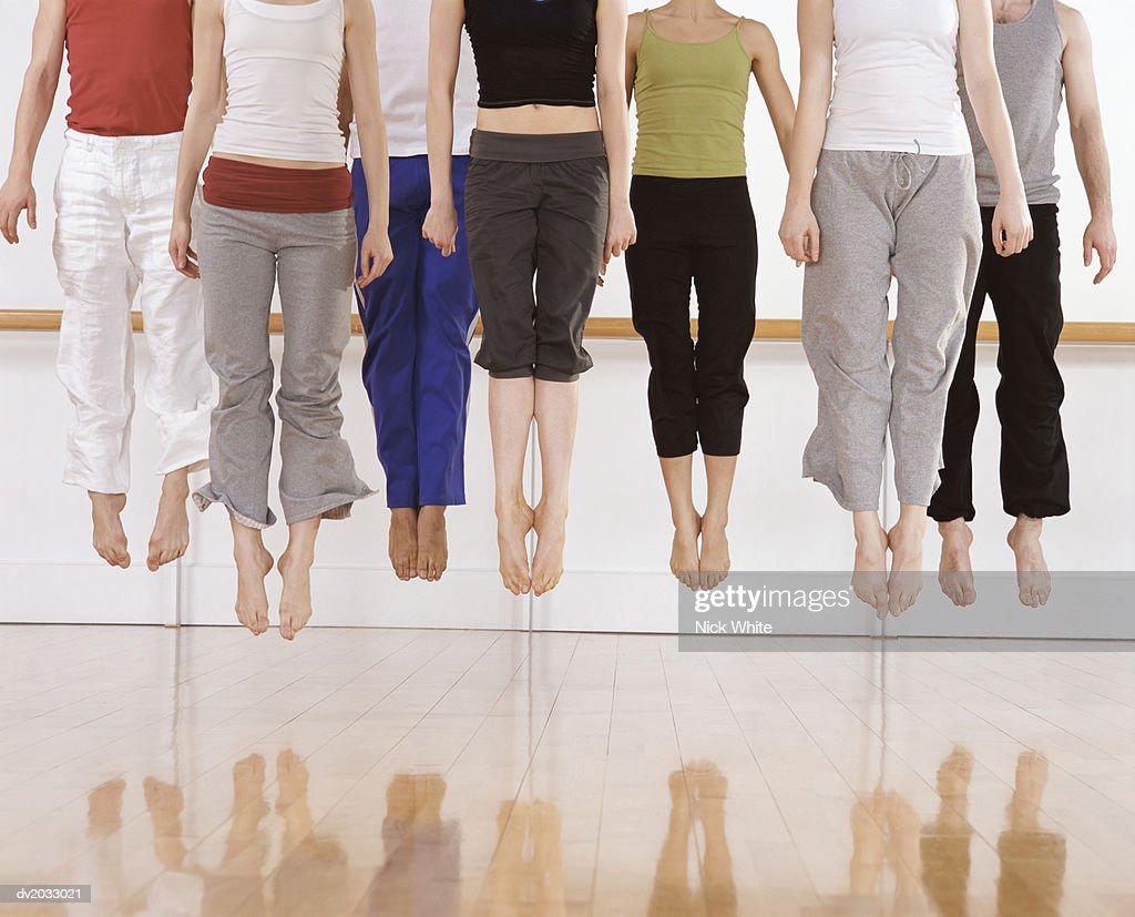 Seven Ballet Dancers Jumping in Mid Air : Stock Photo