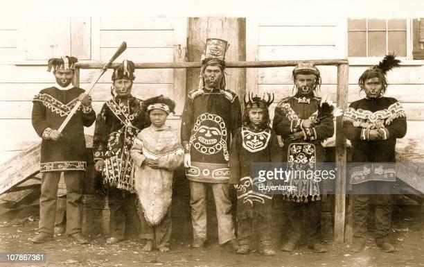 Seven Chilkat Indian men and boys posed standing full length in native dress 1895