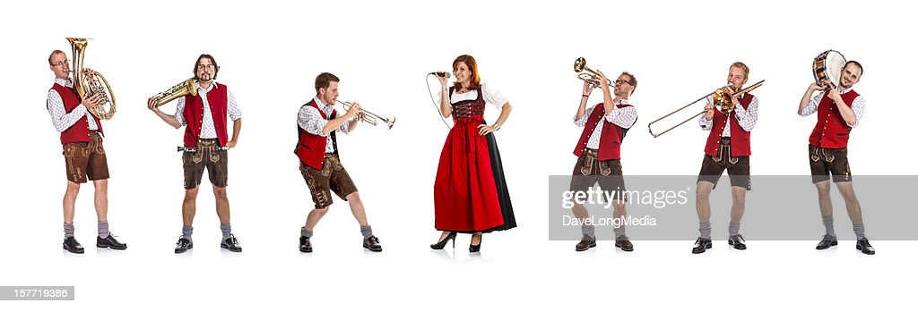 Seven costumed members of a Bavarian/Austrian brass band : Stock Photo