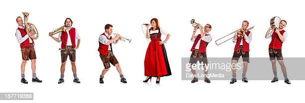 Seven costumed members of a Bavarian/Austrian brass band