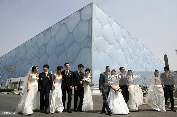 Seven couples attend a group wedding at the National Aquatic Centre or 'Water Cube' on April 26 2008 in Beijing China The seven staff members of...