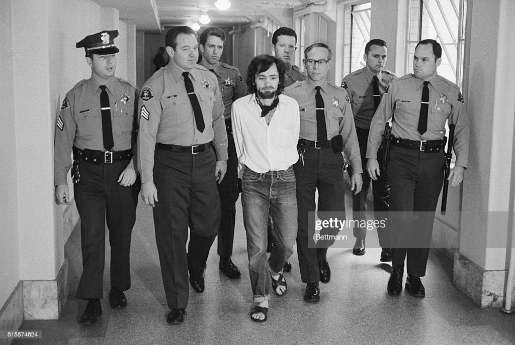 Seven deputies escort Charles Manson from the courtroom after he and three followers were found guilty of seven murders in the Tate-LaBianca slayings.