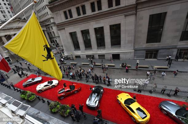 Seven Ferrari cars are seen in front of the NYSE after Ferrari NV led by Chairman Sergio Marchionne and members of the companys leadership team ring...