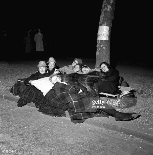 Seven girls from Australia and New Zealand bed down in The Mall to make sure of a favorable viewpoint for the wedding of Princess Alexandra and Angus...