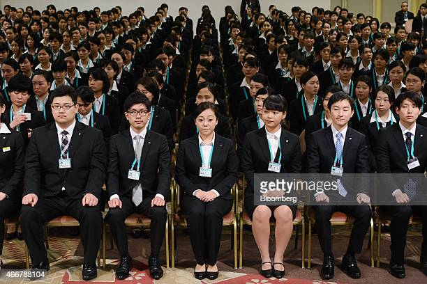 Seven I Holdings Co new employees attend an initiation ceremony in Tokyo Japan on Thursday March 19 2015 Japan's labor market is the tightest in 23...