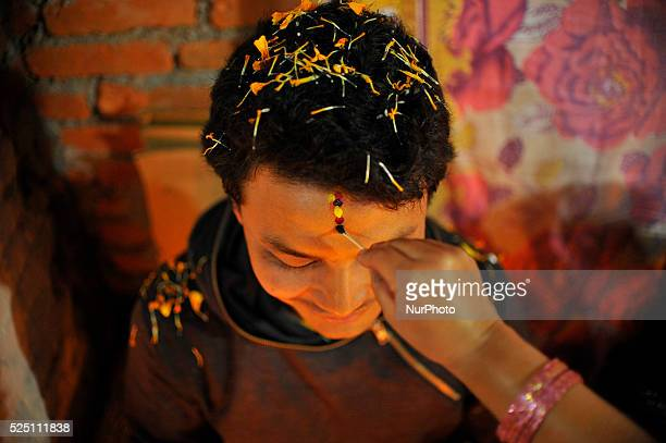 Seven layers of colorful vermilion powder applying on a brothers forehead by sister on the fifth and last day of Tihar is called Bhai Tika or Kija...