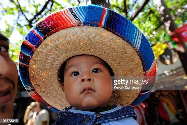 Seven month old Alexander Mendoza and his father Alfonso Mendoza attend Cinco de Mayo festivities on May 5 at El Pueblo de Los Angeles Historic Site...