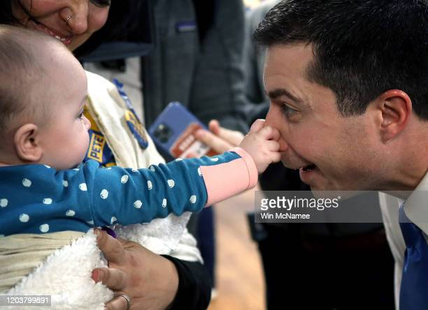 Seven month old Emerson Buckman grabs the nose of Democratic presidential candidate former South Bend Indiana Mayor Pete Buttigieg during a...