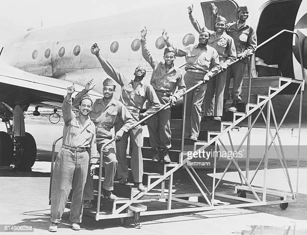 Seven New York and New Jersey servicemen from the 16 member 99th Pursuit Squadron arrive at La Guardia aboard a TransAtlantic ATC plane The Squadron...
