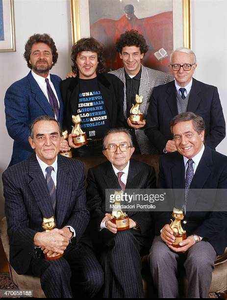 'Seven of the main public figures of the past year pose together holding the award just received a Telegatto on top from the left they are comedian...