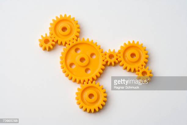 Seven orange cogs interlocked