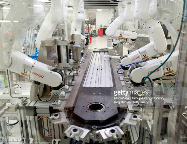 Seven robotic arms assemble different parts of a 5mm trocar seal and perform three quality tests on the device at Applied Medical in Rancho Santa...
