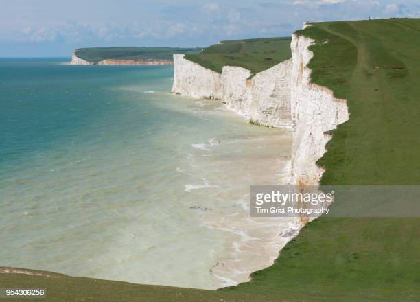 seven sisters cliffs and beach - english channel stock photos and pictures