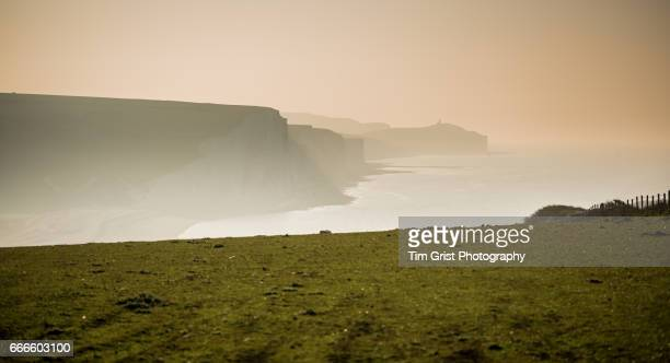seven sisters cliffs in sea mist - seven sisters cliffs stock photos and pictures