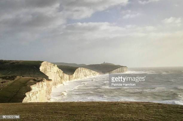 seven sisters cliffs on a windy day - english channel stock photos and pictures