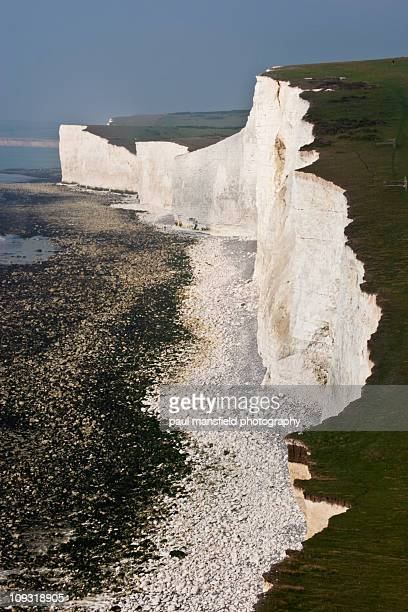 seven sisters coastline at low tide - seven sisters cliffs stock photos and pictures