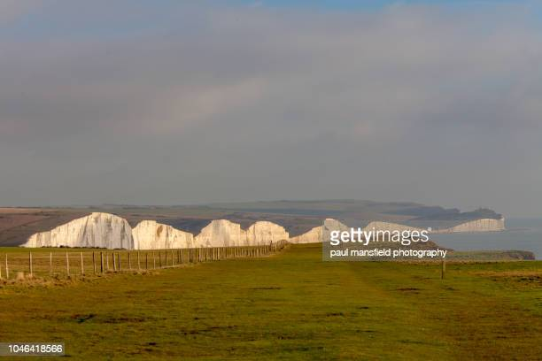seven sisters coastline - seven sisters cliffs stock photos and pictures