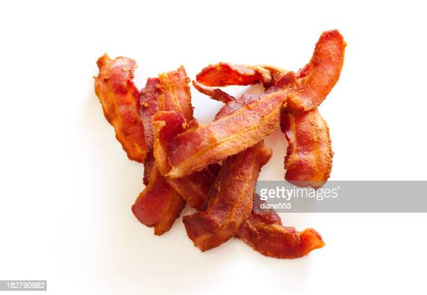 Seven Slices of Crispy Cooked Bacon in Pile On White