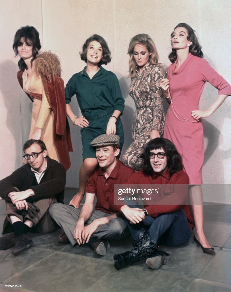 Seven stars of Woody Allen's film, 'What's New Pussycat', Paris 1964. Seated, left to right, Woody Allen, Peter O'Toole and Peter Sellers (1925 - 1980), standing behind them (left to right) Paula Prentiss, Romy Schneider (1938 - 1982), Ursula Andress and Capucine (1933 - 1990).
