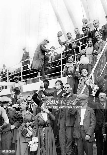 Seven steamships carrying 7,000 people, including these steerage passengers aboard the Conte Rosso, arrive at Ellis Island after a race in fog and...