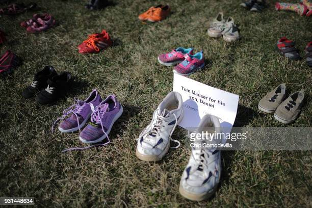 Seven thousand pairs of shoes representing the children killed by gun violence since the mass shooting at Sandy Hook Elementary School in 2012 are...