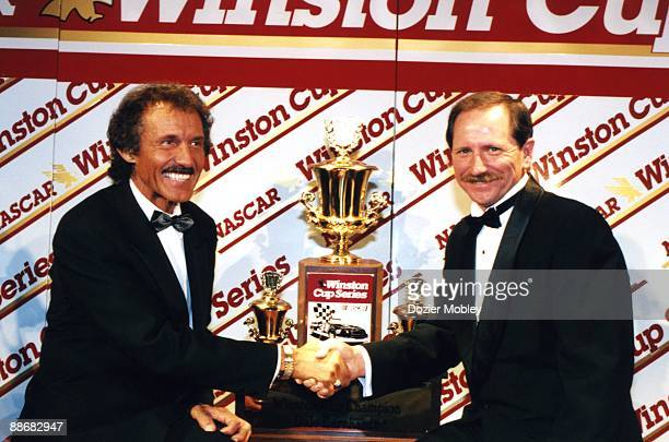 Seven time Winston cup Champion Richard Petty congratulates Dale Earnhardt on his seventh championship during the annual Awards Banquet on December...