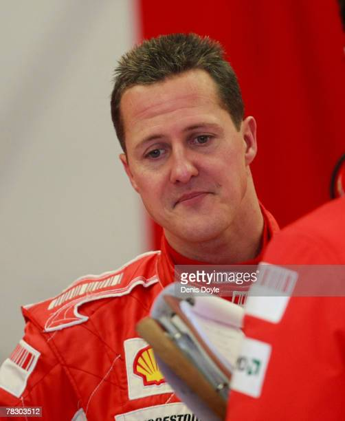 Seven times world champion Michael Schumacher of Germany chats with a Ferrari mechanic during Formula One Testing at the Circuito de Jerez on...