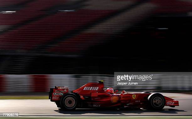Seven times world champion Michael Schumacher of Germany drives his car while testdriving for Ferrari during Formula One testing at the Circuit de...