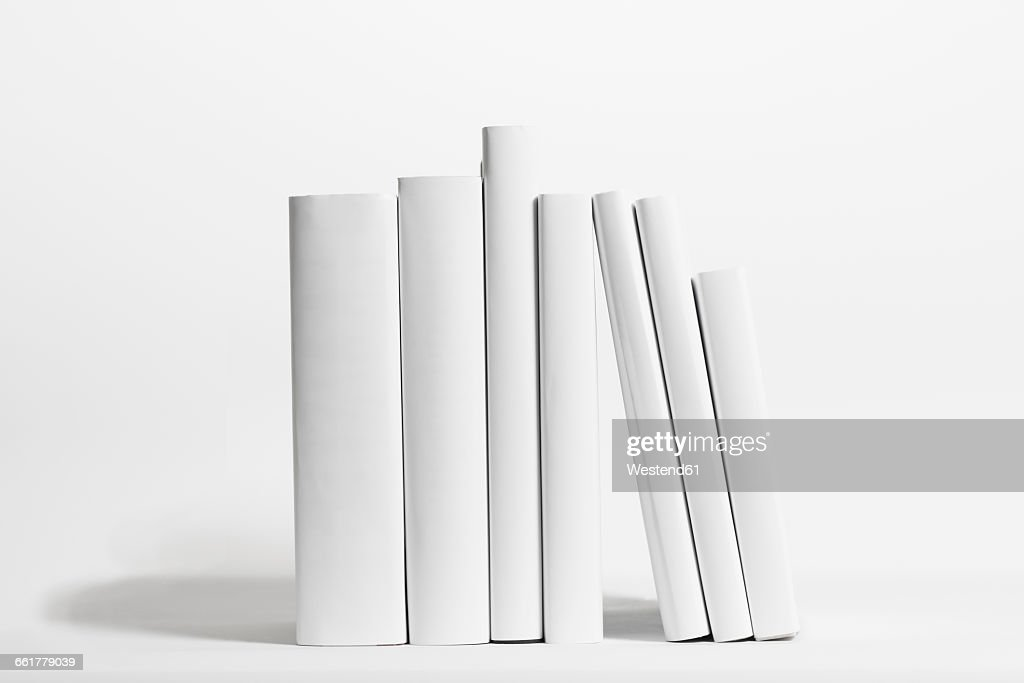 Seven white books in front of white background : Stock Photo