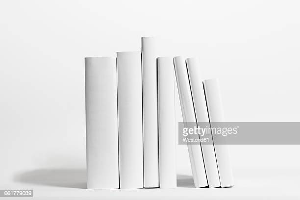 seven white books in front of white background - book imagens e fotografias de stock