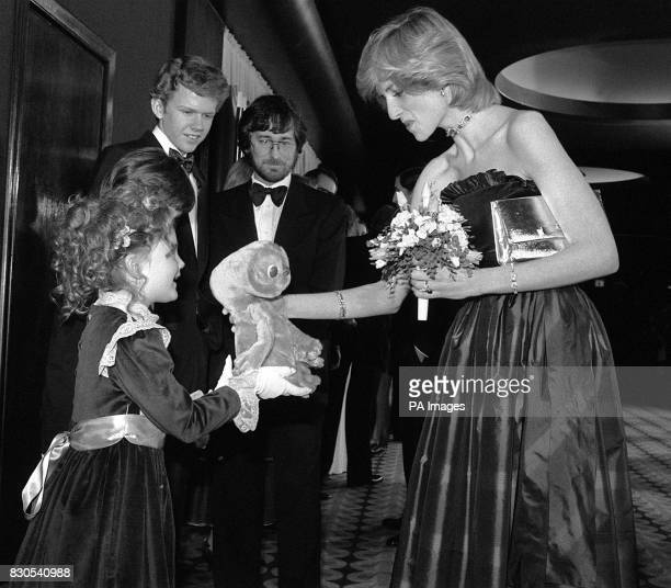 Seven year old American actress Drew Barrymore , star of the movie ET, presents the Princess of Wales with a cuddly toy version of the film's main...