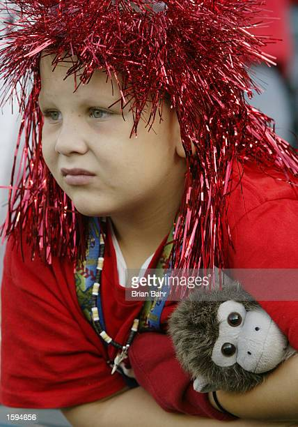 Seven year old Anaheim Angel fan William Teah from Rancho Santa Margarita watches warm ups with his monkey friend prior to the start of game seven...