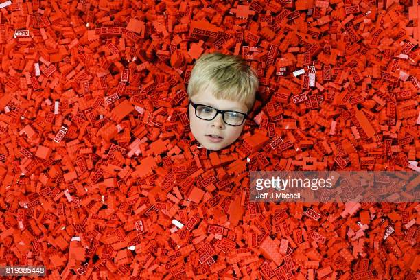 Seven year old Ben MacDonald submerses himself in Lego during Bricklive at the Scottish Exhibition and Conference Center on July 20 2017 in Glasgow...