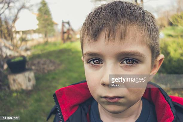 Seven year old boy's portrait in nature