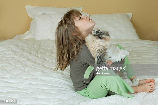 Seven year old girl with her dog (Shih Tzu)