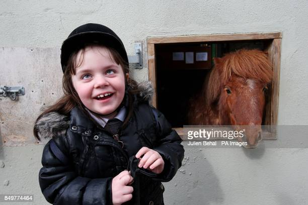 Seven year old Little Eva Kennedy from ChildVision Ireland's only Education Centre for Blind Children meets Shergar in the stables of the Equine...