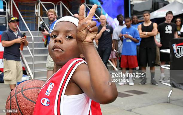 Seven year old Shekeem O'Connor proudly wears his signed Chicago Bulls Luol Deng vest following an NBA JamVan press event in Trafalgar Square in...