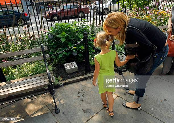 Seven yearold Sophie Ostroy daughter of Adrienne Shelly is shown the plaque dedicated in memory of Adrienne Shelly at the Adrienne Shelly Memorial...
