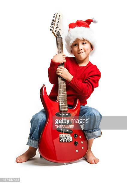 seven years old santa kid with red guitar