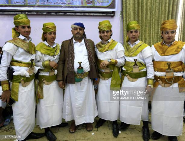 Seven Yemeni grooms between the ages of 14 and 17 take part in a mass wedding in the rebelheld Yemeni capital Sanaa on February 26 2019 The boys who...