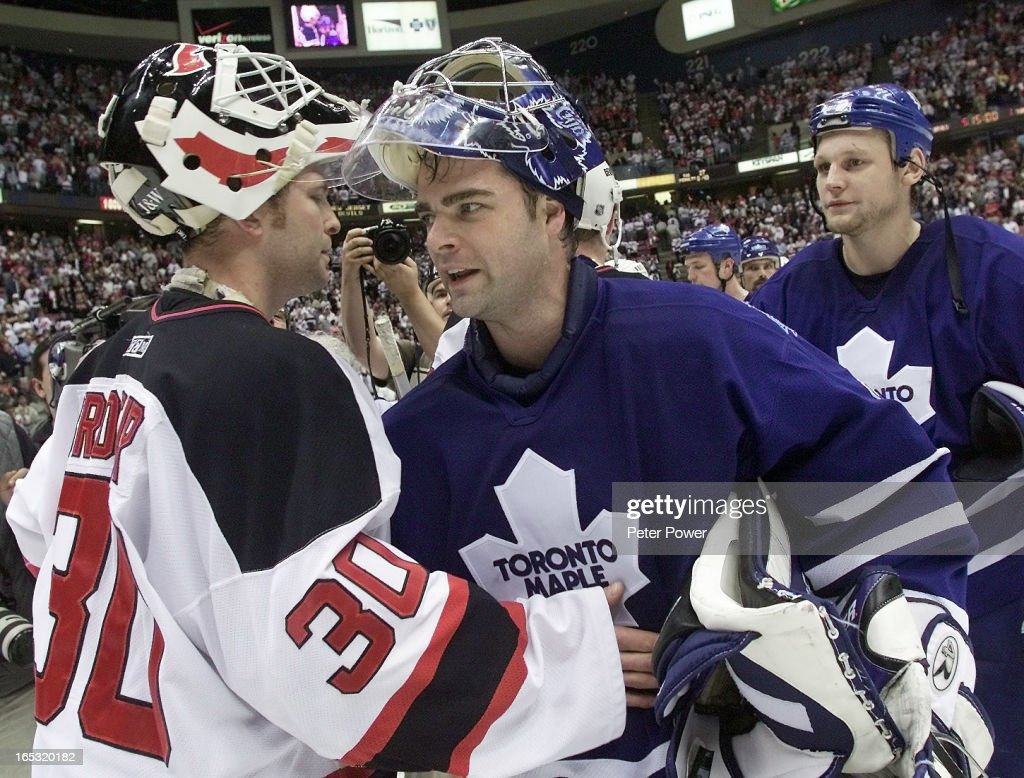 DIGITAL IMAGE-05/09/01-LEAFS VS DEVILS-GAME SEVEN-Curtis Joseph and Martin Brodeur exchange a few wo : News Photo