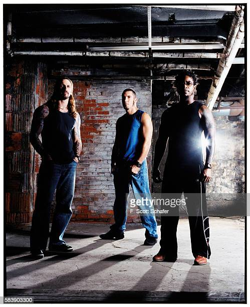 John Connelly Clint Lowery and Lajon Witherspoon are photographed for Muscle and Fitness Magazine in 2003