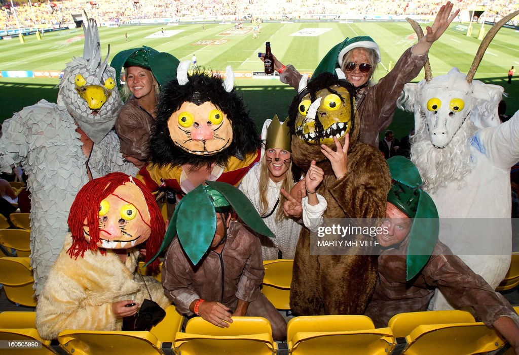Sevens fans enjoys the atmosphere at the Westpac Stadium on day two of the fourth leg of the IRB Rugby Sevens World Series in Wellington on February 2, 2013. AFP PHOTO / Marty MELVILLE