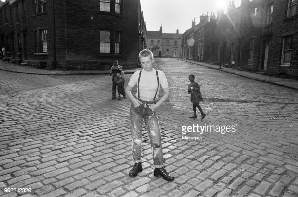 Seventeen year old skinhead teenager Janet Askham poses in the street at her home in Huddersfield, West Riding of Yorkshire, 6th June 1970.