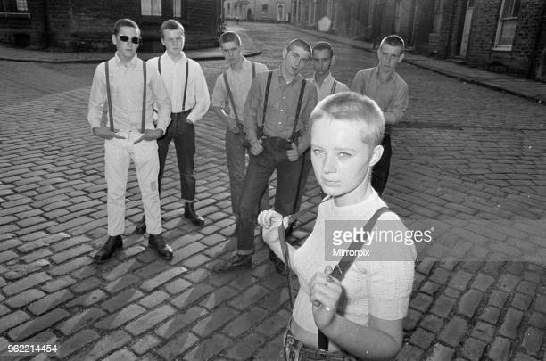 Seventeen year old skinhead teenager Janet Askham poses with her friends at her home in Huddersfield, West Riding of Yorkshire, 6th June 1970.