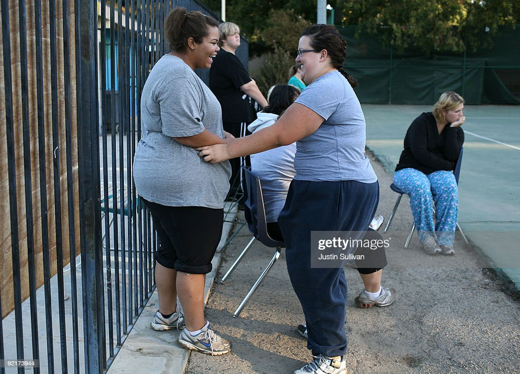 Seventeen year-old Marissa Hamilton (L) is tickled by her friend Elizabeth Fedorchalk after a morning walk at Wellspring Academy October 19, 2009 in Reedley, California. Struggling with her weight, seventeen year-old Marissa Hamilton enrolled at the Wellspring Academy, a special school that helps teens and college level students lose weight along with academic courses. When Marissa first started her semester at Wellspring she weighed in at 340 pounds and has since dropped over 40 pounds of weight in the first two months of the program. According to the Centers for Disease Control and Prevention, 16 percent of children in the US ages 6-19 years are overweight or obese, three times the amount since 1980.